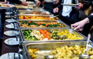 Catered buffet line with chafers